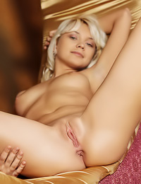 Hot blonde lady Lada D takes off her purple satin robe and shows us her tight little butt.