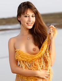 Hot and dirty brunette gal Lorena B strips in the ocean and plays naugthy in the mud.