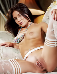 Passionate brunette Kayla B poses in her classy bedroom in her expensive white lace lingerie.
