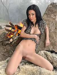 Helen H went out camping and now she relaxes fully nude by the campfirea and warms her fanny.