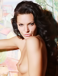 Cartier A: Brunette vixen Cartier A poses in her living room fully naked and teases us with her booty.