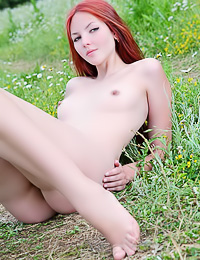 Beautiful redhead babe Nalli A takes off her thongs outdoors and shows her hairy muff.