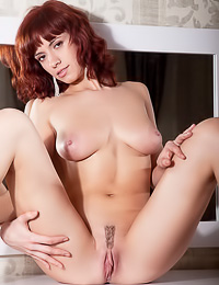 Leka C: Classy redhead model Leka C takes her black lace top off and shows her massive big jugs.