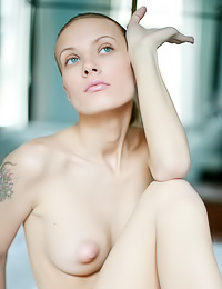 Tattooed babe Svea A takes off her clothes for the camera and showes her large perky nipples.