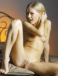 Smoking hot blonde gal Tamara F poses nude in front of the camera and shows her hungry cunt.