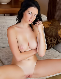 Busty brunette vixen Jessica E takes off her clothes and shows us her big bouncy jugs.