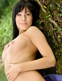 Attractive brunette gal Alyssia A takes off her denim shorts outdoors and shows her hot muff.