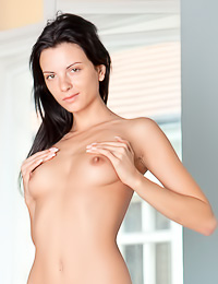 Foxy brunette gal Anastasia C takes off her black lingerie and shows her fully shaved muff.
