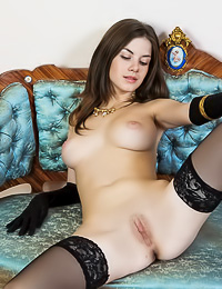 Big breasted brunette gal Anita C spreads her legs and shows us her pussy in stockings.