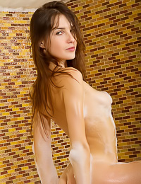 Busty brunette cuttie Semmi A takes off her clothes and takes a hot steamy bath for the camera.