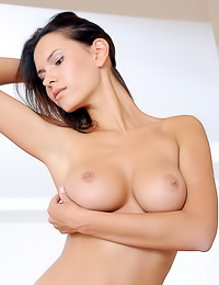 Suzanna A takes all of her clothes off and teses us with her fantastic big round melons.